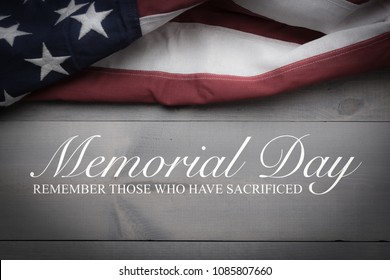 The flag of the United Sates of America on a grey plank background with memorial day - Shutterstock ID 1085807660