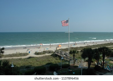 Flag of the United States of America blowing in the wind at Myrtle Beach South Carolina