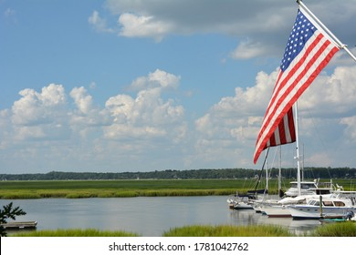 The flag of the United States of America hangs over marshland of South Carolina.