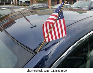 flag of the United States of America on blue car
