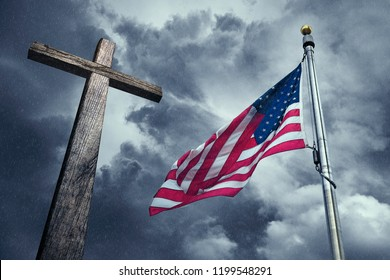 Flag of the United States of America on a rainy summer day with a wooden cross. Symbolizing the blessing of God on America.