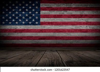 Flag of United States of America on brick old wall. Dark room with wooden floor.