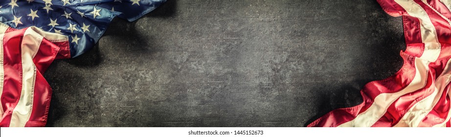 Flag of United States of America on a concrete background. Usa flags and stripes as a panoramic banner.