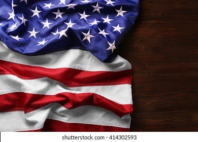 Flag of United States of America on wooden table closeup