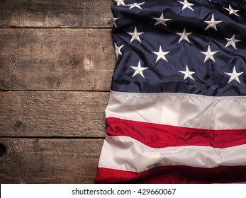 The flag of the United States of America on rustic barn wood