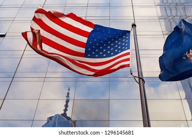Flag of the United States in front of the skyscrapers in New York