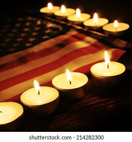the flag of the United States and lighted candles