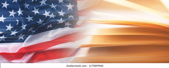 Flag of United States and opened book. Concept of education, history or law.