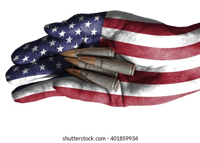Flag of United States overlaid the hand of an adult man holding four bullets. Conceptual image for war, violence, conflicts. Image isolated on white background