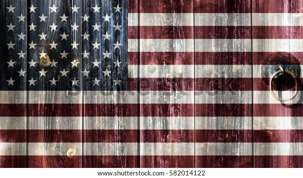 Flag of the United States painted on an old wooden door.