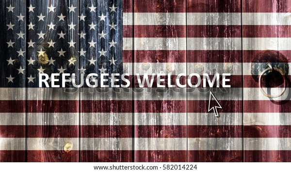 Flag of the United States painted on an old wooden door. Next to the door handle text Refugees Welcome