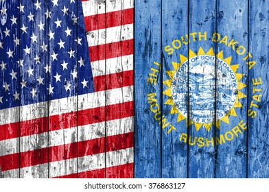 Flag of US and South Dakota painted on wooden frame
