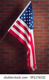 Flag of the USA before brick wall