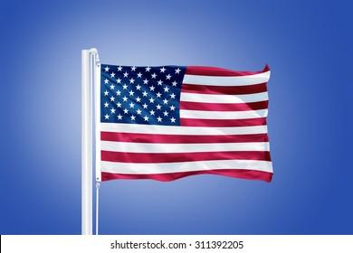 Flag of USA flying against a blue sky.