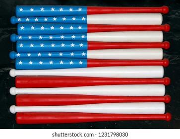 flag of usa on baseball bats on wall