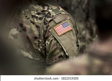 Flag of USA on soldiers arm. Veterans Day. The United States Armed Forces. Military forces of the United States of America. Remembrance Day. Memorial day.