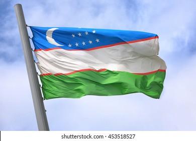 Flag of Uzbekistan against the sky