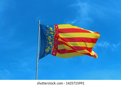 Flag of Valencia blowing in the wind