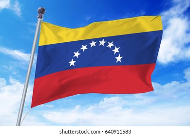 Flag of Venezuela developing against a clear blue sky