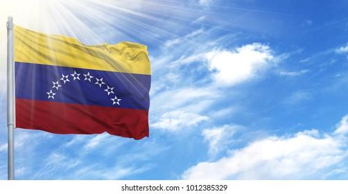 Flag of Venezuela on flagpole against the blue sky