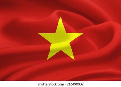 Flag of Vietnam waving in the wind. Silk texture pattern