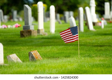 Flag waiving in the cemetery during memorial day
