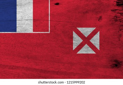 Flag of Wallis and Futuna on wooden plate background. Grunge Wallis and Futuna flag texture, red saltire on a white square, the flag of France in the upper.