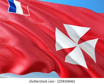 Flag of Wallis And Futuna waving in the wind against deep blue sky. High quality fabric.