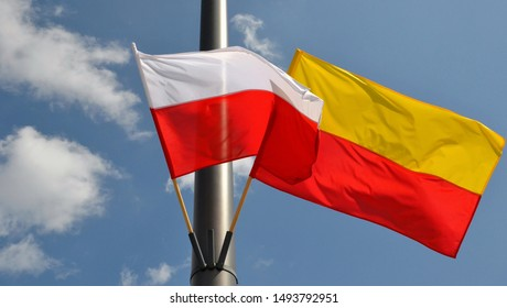 Flag of Warsaw (horizontal bands: yellow and red ) and Flag of Poland (two  bands: white and red). Flags waving on the pole, displayed in public places on national holidays and other important days