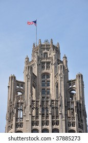 Flag waving atop the Tribune Tower in Chicago, Illinois.