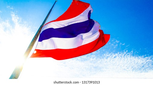 Flage of Thailand. Thai flage waving with clear beauty blue sky.