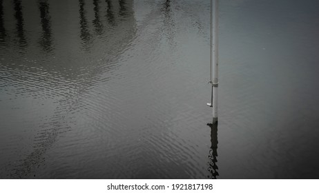 the flagpole is in the middle of the flood