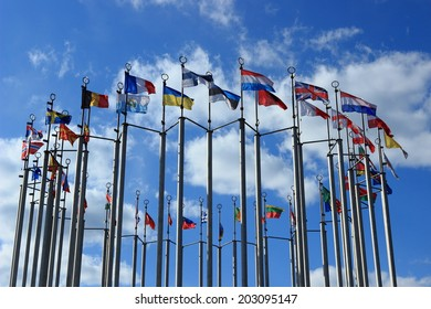 Flags against blue sky on European square in Moscow, Russian Federation