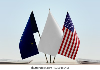 Flags of Alaska and USA with a white flag in the middle