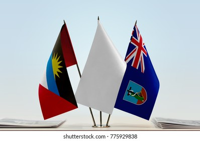 Flags of Antigua and Barbuda and Montserrat with a white flag in the middle