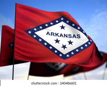 flags of Arkansas on blue sky background