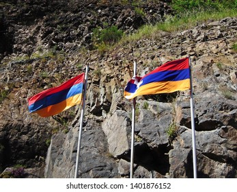 Flags of Armenia and Republic of Artsakh (known as Nagorno Karabakh Republic) are waving on wind. Picture taken near border between these countries
