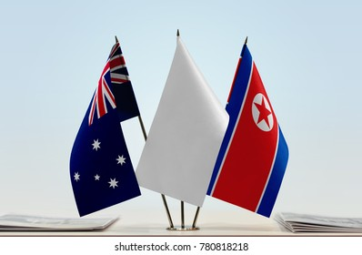 Flags of Australia and North Korea with a white flag in the middle