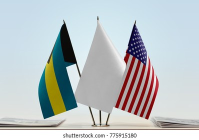 Flags of Bahamas and USA with a white flag in the middle