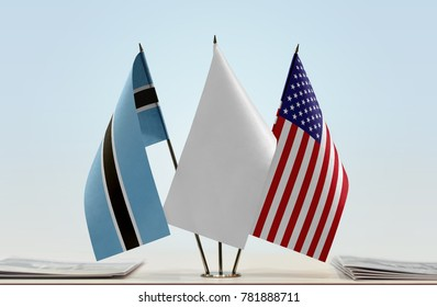 Flags of Botswana and USA with a white flag in the middle