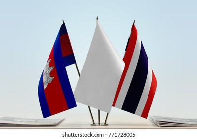 Flags of Cambodia and Thailand with a white flag in the middle