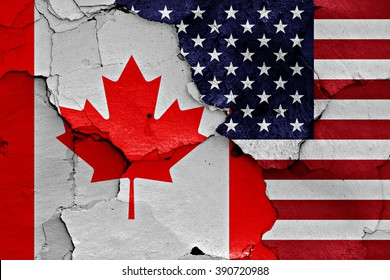 flags of Canada and USA painted on cracked wall