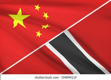 Flags of China and Republic of Trinidad and Tobago blowing in the wind. Part of a series.