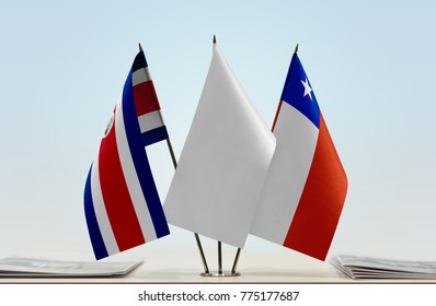 Flags of Costa Rica and Chile with a white flag in the middle