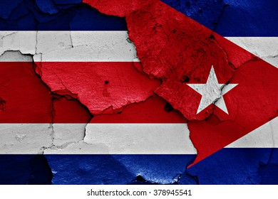 flags of Costa Rica and Cuba painted on cracked wall