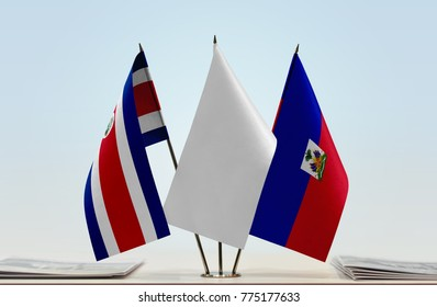 Flags of Costa Rica and Haiti with a white flag in the middle
