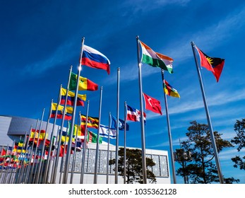 Flags of the countries of the world on flagpoles in Expo center. Yeosu city. South Korea. Winter 2018