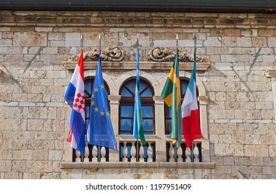 Flags of Croatia, Europe, Istria Pula and Italy at the Town Hall of Pula, Croatia