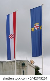 Flags of Croatia and Rovinj Town at Flagpoles