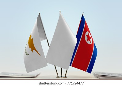 Flags of Cyprus and North Korea with a white flag in the middle